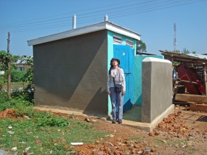 Rachel Wales inspected the new town latrines provided by the Ross Namutumba Link and built by Namutumba Council. They are opposite the bus stops and assist hygiene and health for travellers and residents.